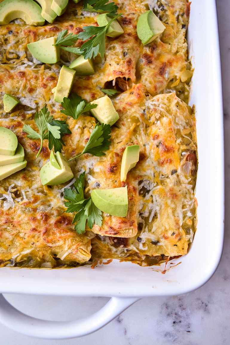 Easy Chicken Enchiladas in a white pan