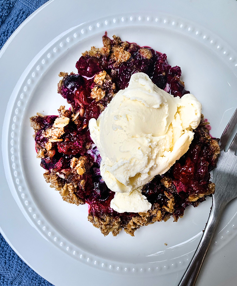 Mixed Berry Crisp on a white plate