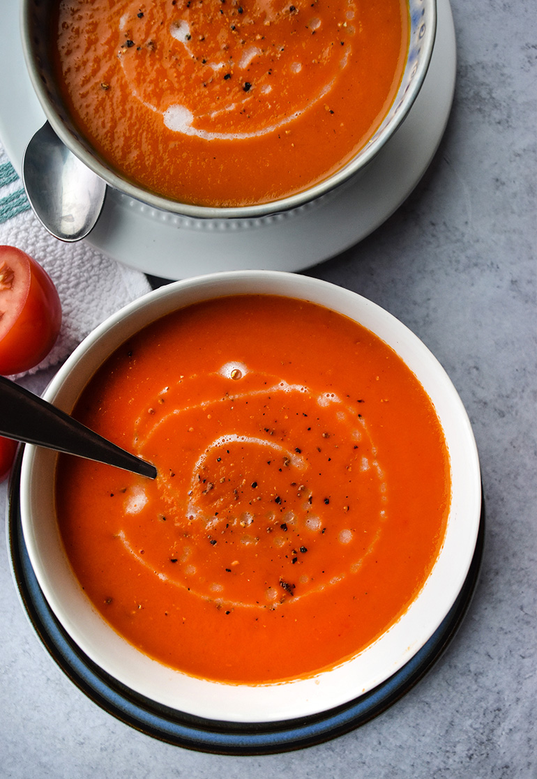 Spicy Roasted Red Pepper Tomato Soup in a blue bowl