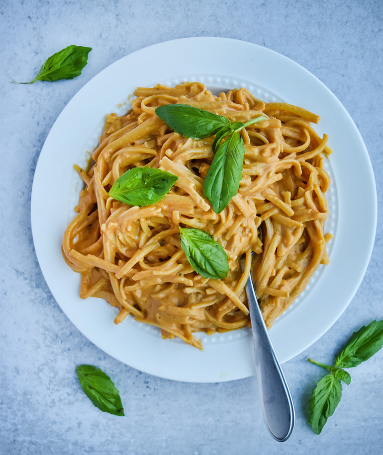 Super Creamy Roasted Red Pepper Pasta on a white plate