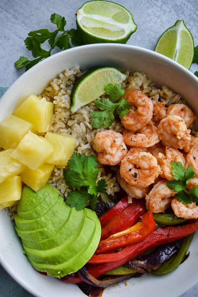 Shrimp and rice in a white bowl