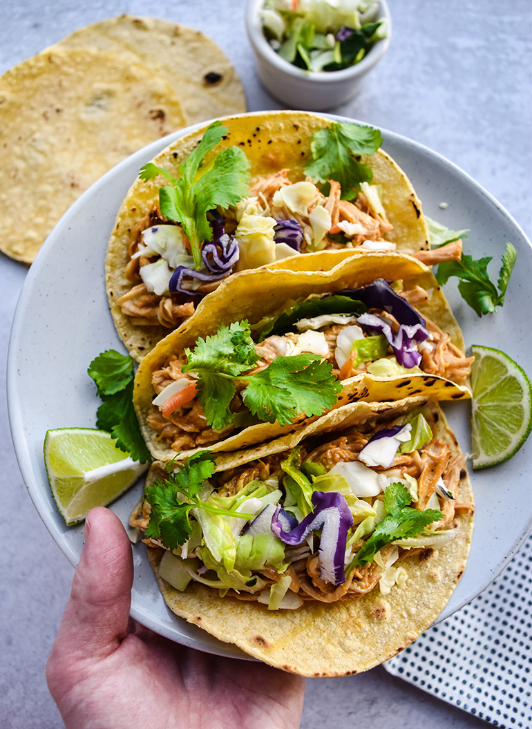 Asian Chicken Tacos on a white plate