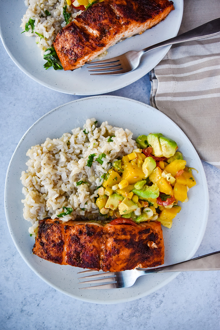 Blackened Salmon with Mango Salsa and Cilantro Lime Rice on a white plate