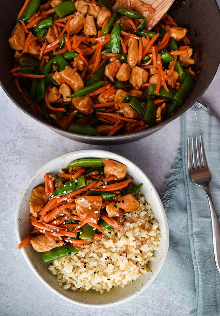 Sesame Chicken Stir Fry in a white bowl