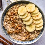 Cinnamon Roll Overnight Oatmeal in a blue bowl