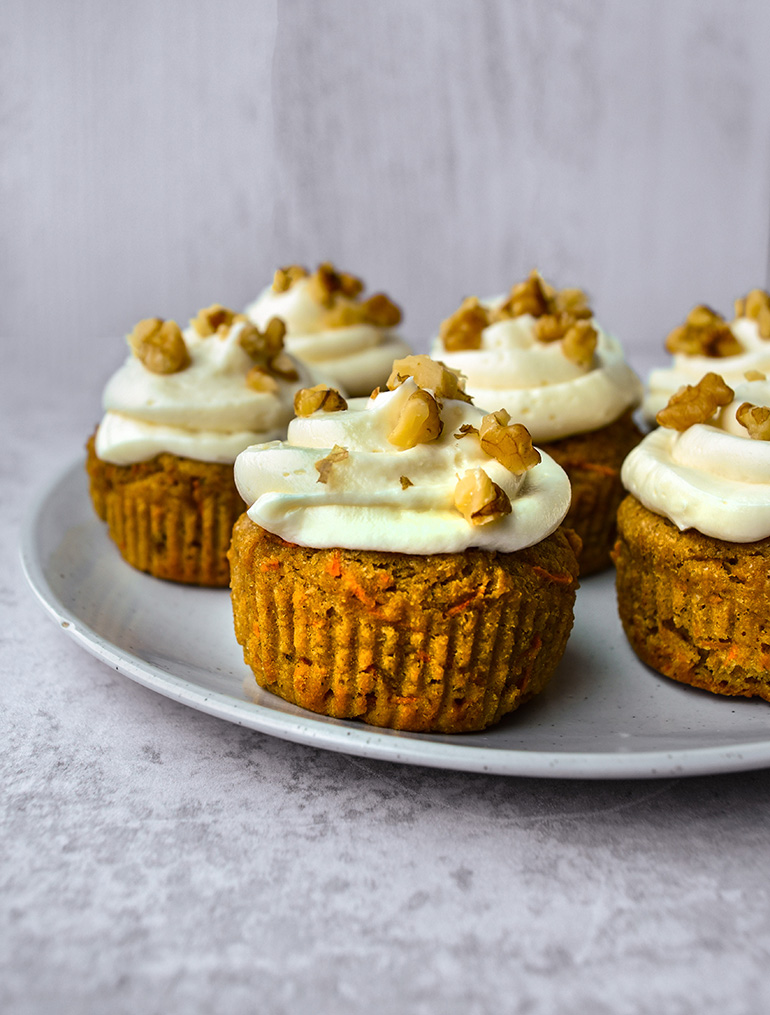 Healthy Carrot Cake Cupcakes with walnuts and icing