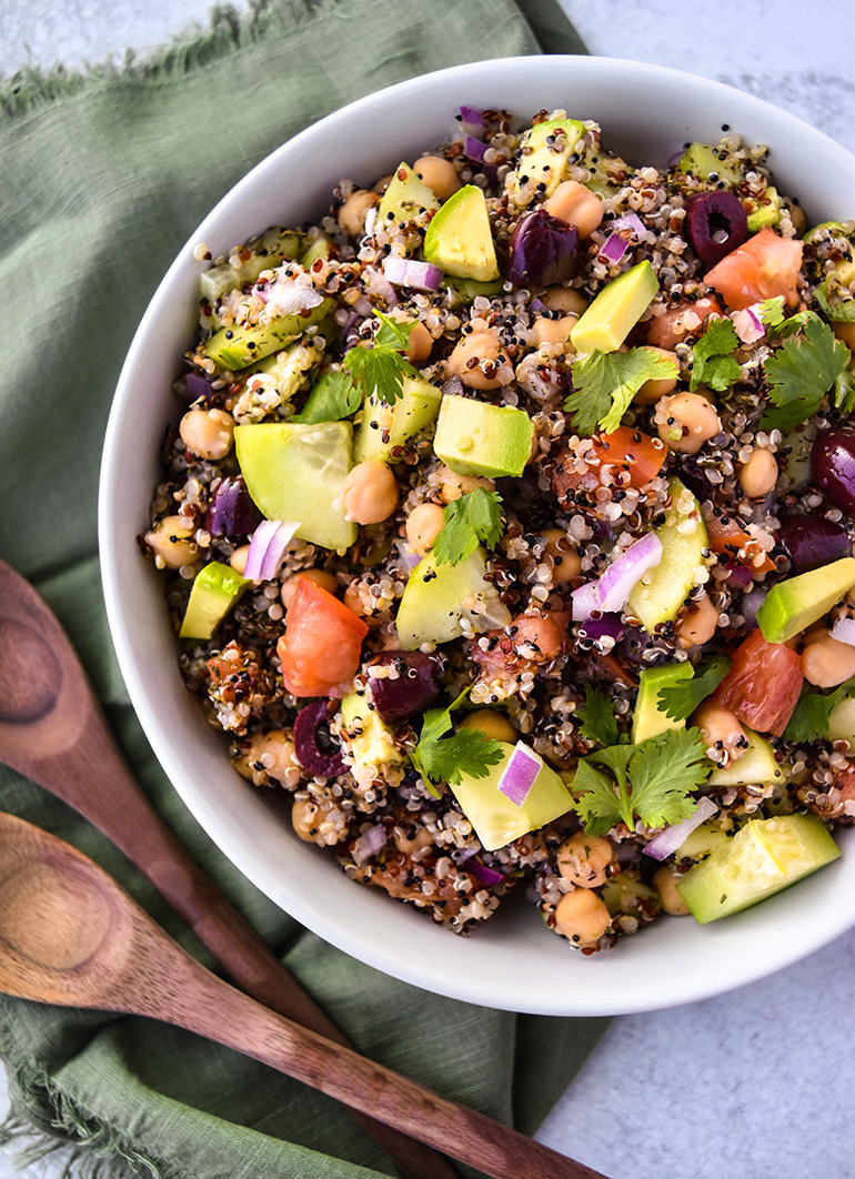 Mediterranean Quinoa Salad in a white bowl