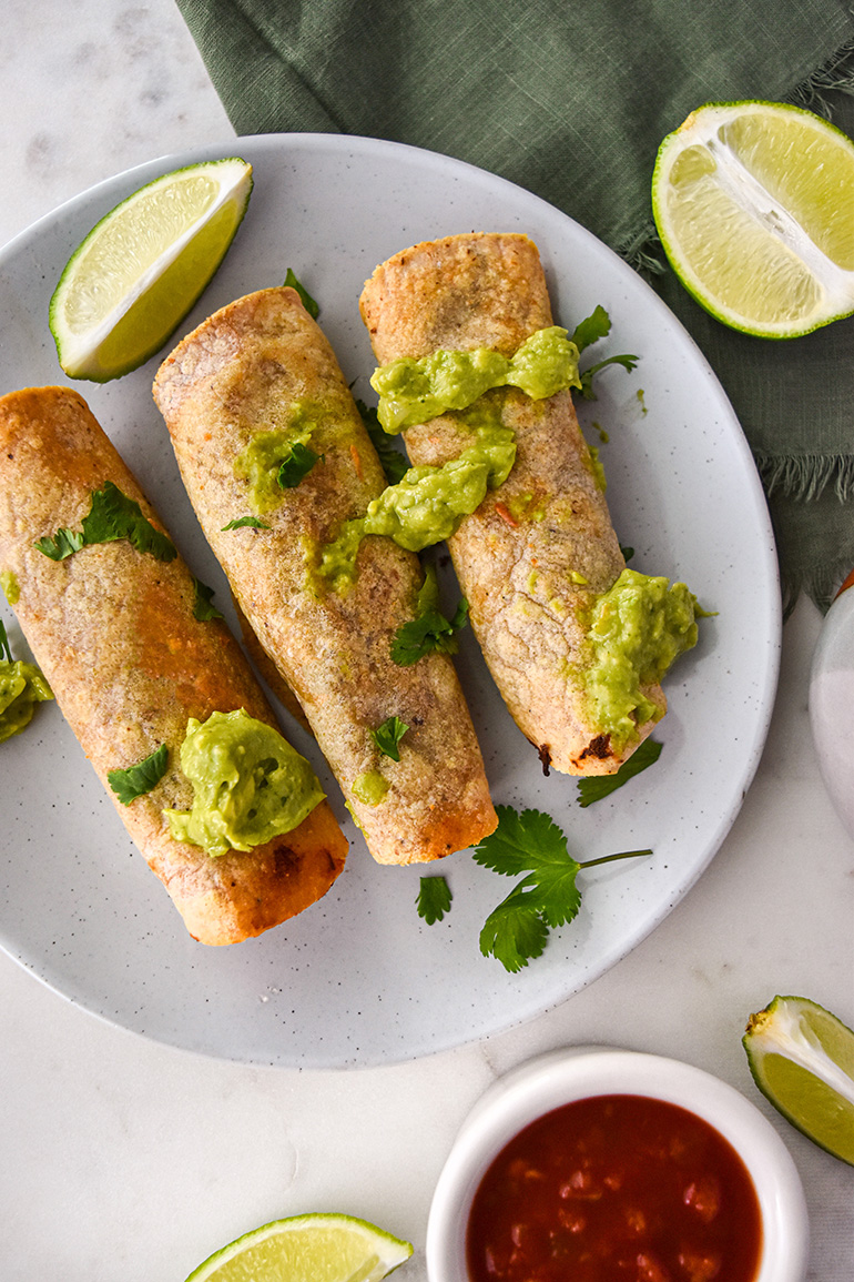 Baked Crispy Jackfruit Taquitos on a white plate