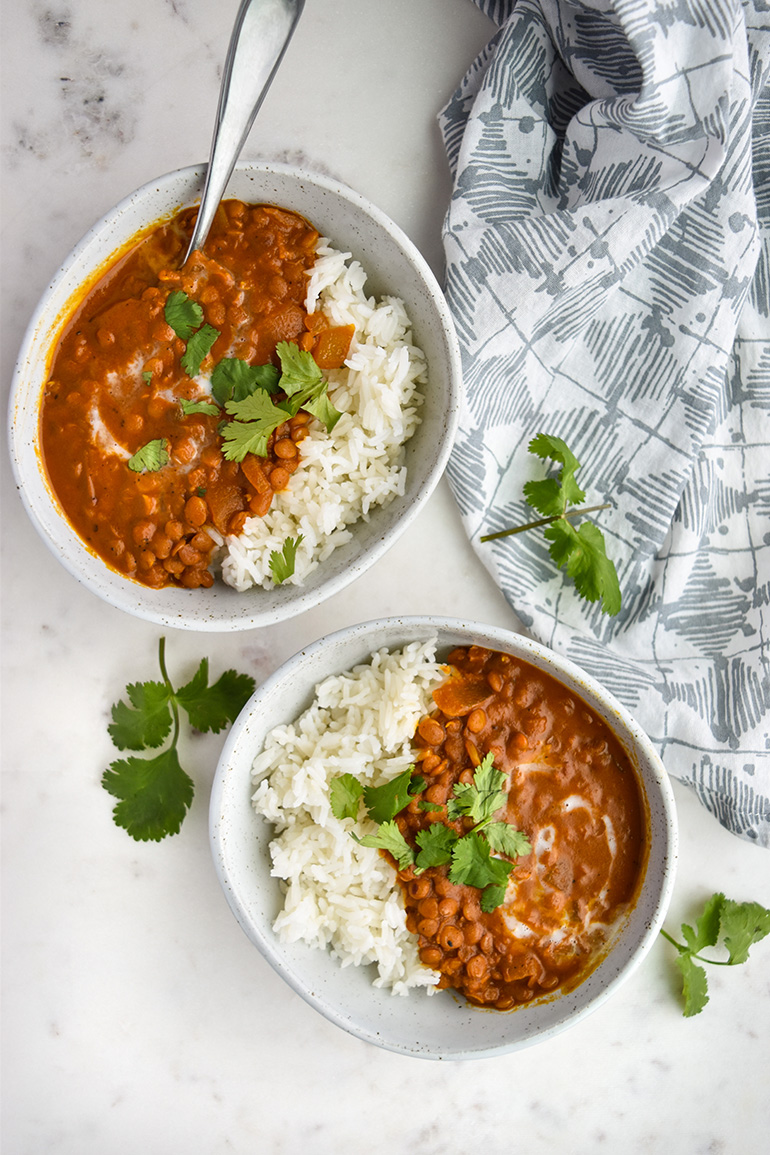 Creamy Coconut Lentil Curry in two white bowls