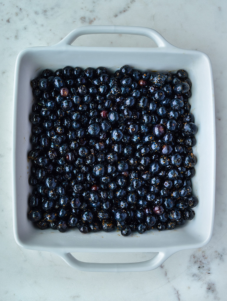 a white pan with blueberries