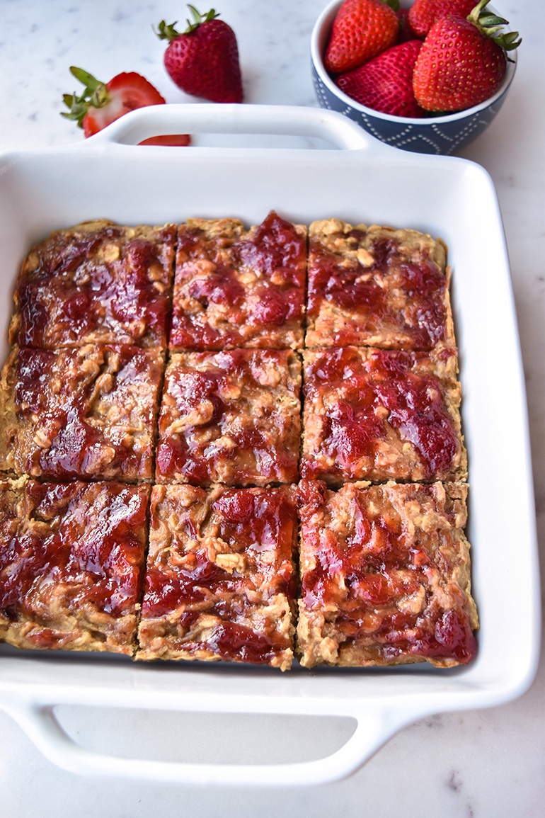 Peanut Butter & Jelly Oatmeal Bake in a white pan