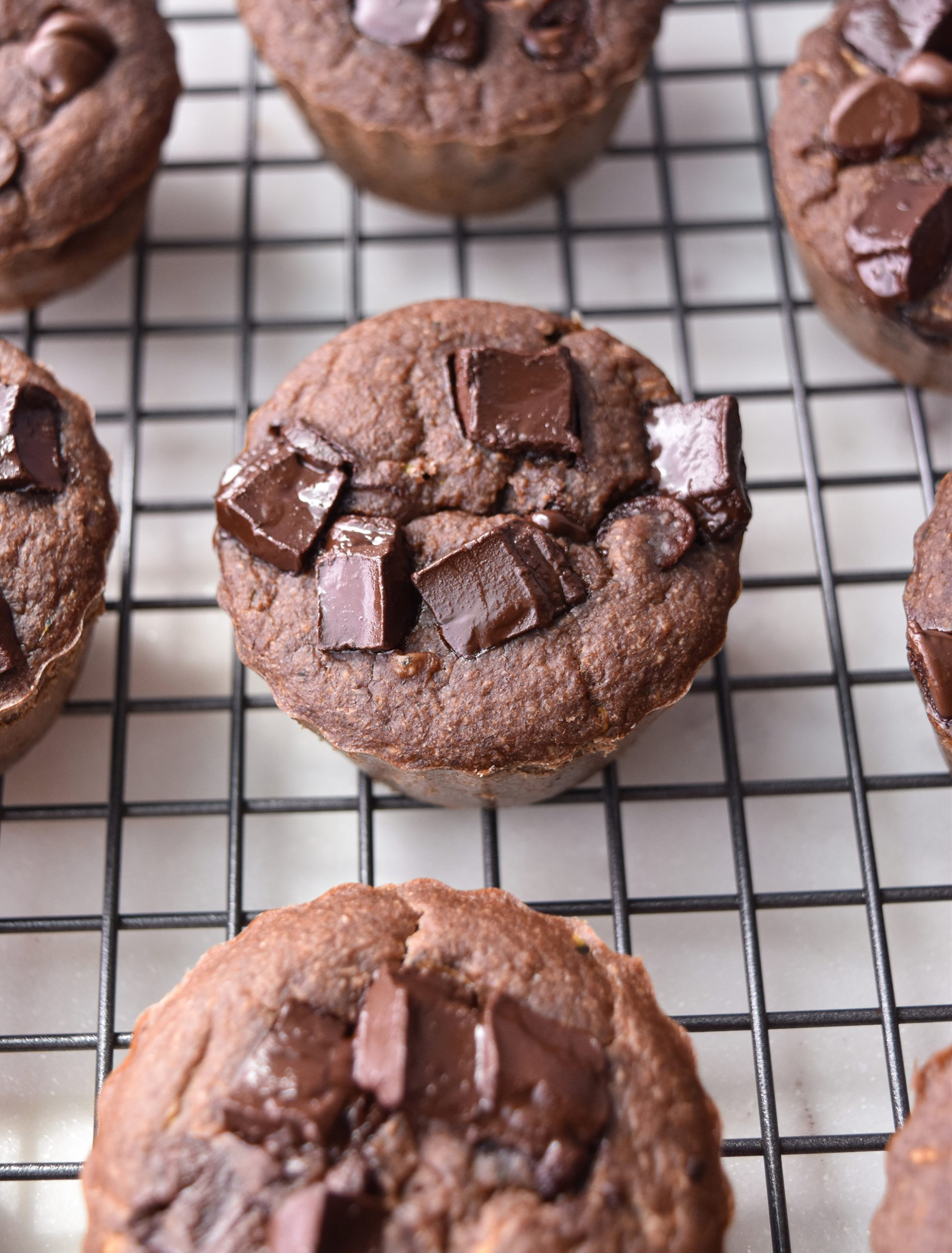 Chocolate Zucchini Blender Muffins on a wire rack