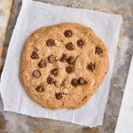Giant chocolate chip cookie on a white plate