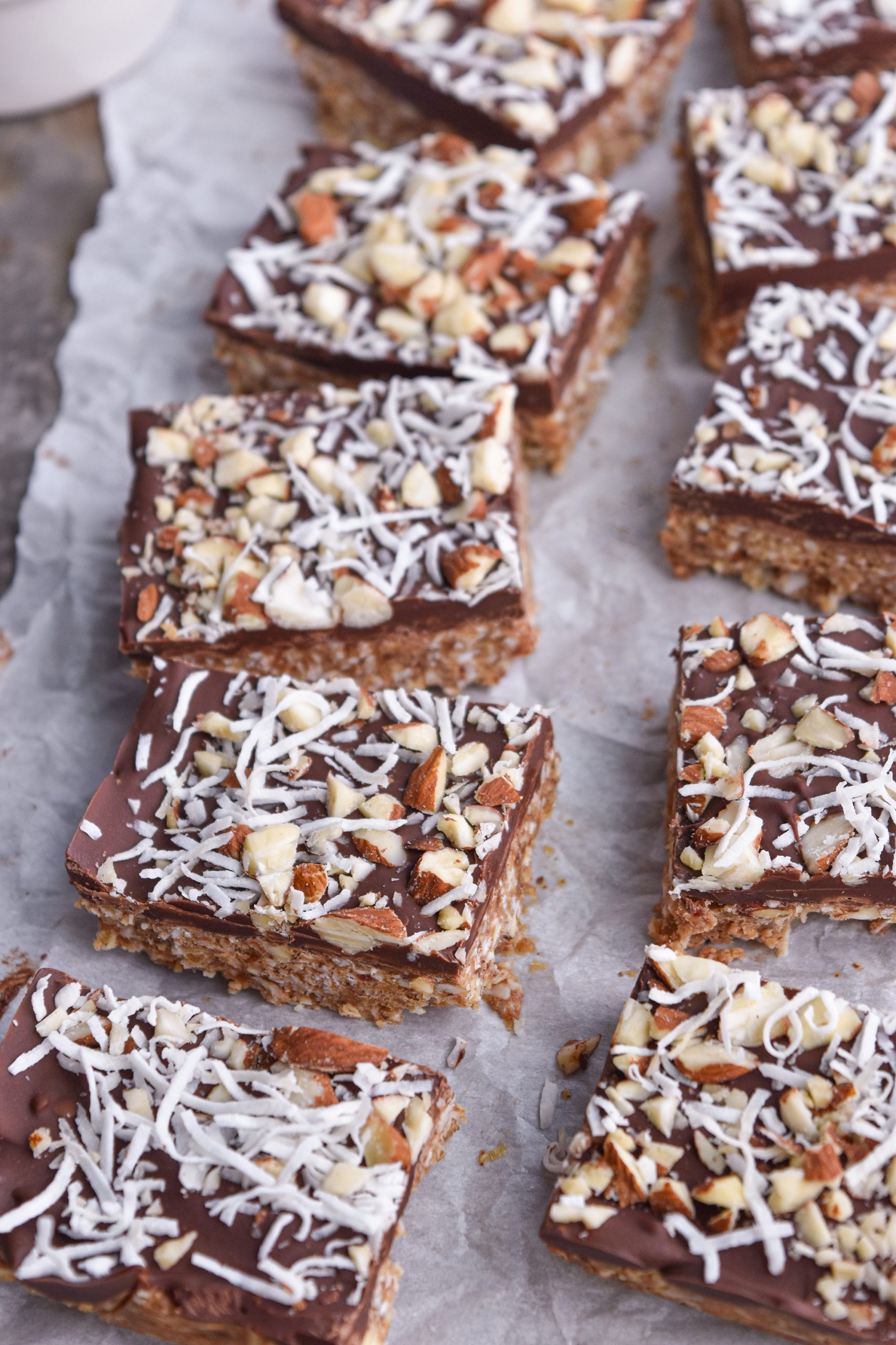 bars with coconut and almonds on top
